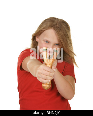 naughty little girl with a slingshot on white - Stock Photo