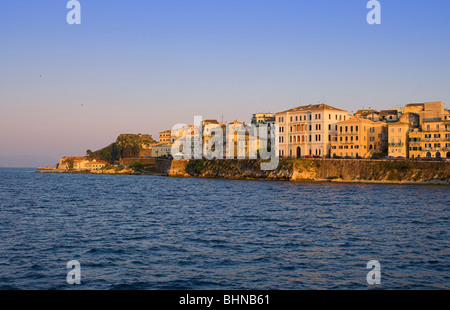 Corfu Town from the sea sunset Venetian style swifts circling above old corfu town - Stock Photo