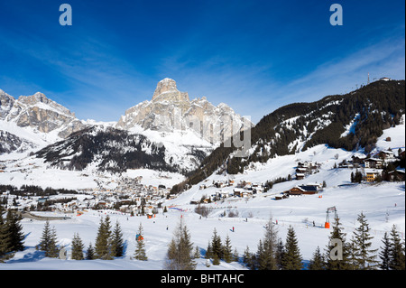 View over the resort of Corvara with Colfosco in the distance, Sella Ronda Ski Area, Alta Badia, Dolomites, Italy - Stock Photo