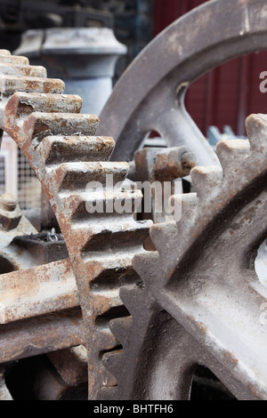 Industrial cog wheels gears interlocking - Stock Photo