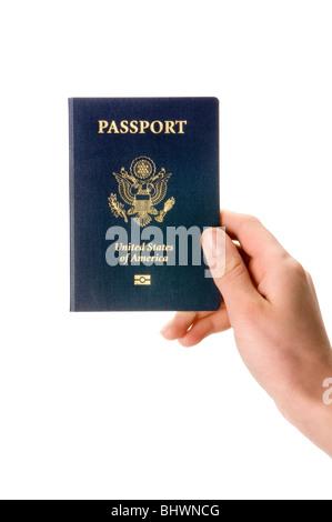 hand holding passport - Stock Photo
