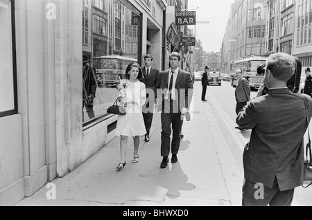 1966 World Cup Tournament in England. England hat trick hero Geoff Hurst with his wife in London on his way to the - Stock Photo