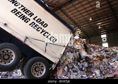 Truck unloading recycling - Stock Photo