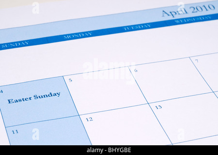 An April 2010 calendar with Easter Sunday highlighted in blue - Stock Photo