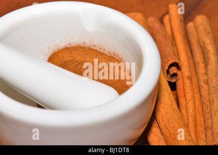 Ground cinnamon and whole sticks - Stock Photo