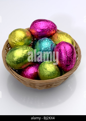 Basket of brightly coloured Easter Eggs. - Stock Photo