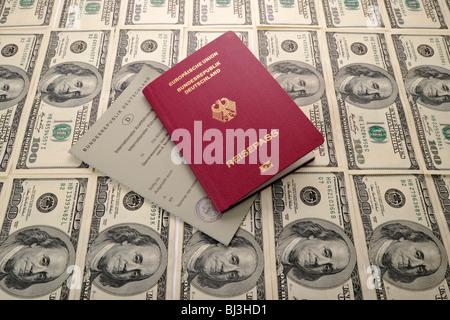 International driving license, German passport, several 100-dollar bills - Stock Photo