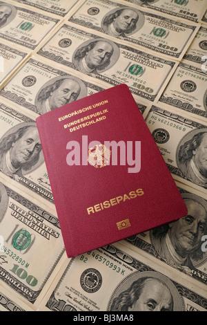 German passport, several 100-dollar bills - Stock Photo