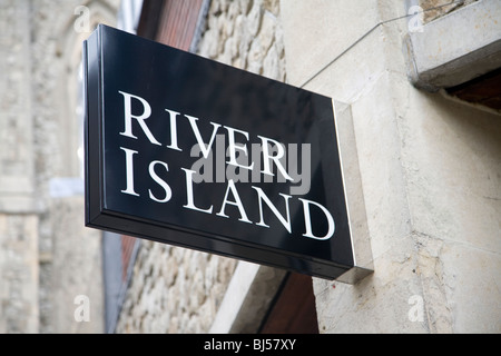 River Island shop sign on wall - Stock Photo