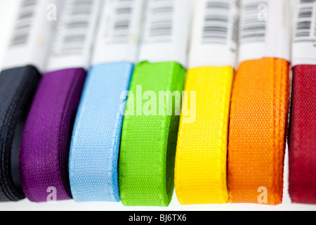 seven rainbow colored ribbons on white background. closeup - Stock Photo