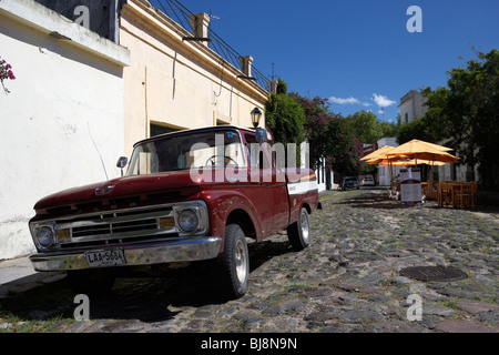 old ford pickup truck on historic paved spanish street with high kerbstones in Barrio Historico Colonia Del Sacramento - Stock Photo