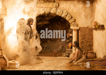 diorama of evangelic scene: the archangel annunciation at Mary - Stock Photo