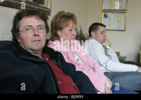 Family torn apart: non-verbal body language, not talking but sit on sofa say nothing - Stock Photo