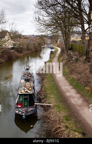 Kennet and Avon canal taken at Bradford on Avon on winters day with canal boat in foreground and path running along - Stock Photo