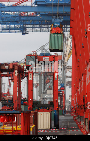 Loading containers at Container Terminal Altenwerder CTA, Hamburg, Germany - Stock Photo