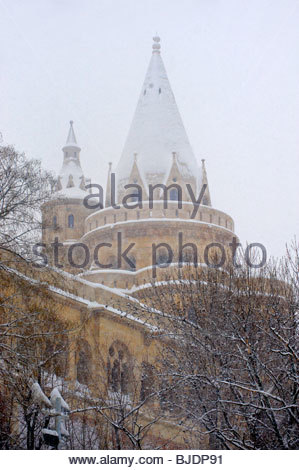 Fisherman's Bastion in the winter snow. Castle district Budapest stock photos - Stock Photo
