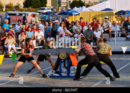 Female Lumberjacks Demonstrating Crosscut Saws at the 2009 Kentucky State Fair in Louisville, Kentucky - Stock Photo