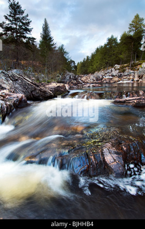 The beautiful Achness Falls at low spate taken at Glen Cassley, Sutherland in Scotland on a bright spring evening - Stock Photo