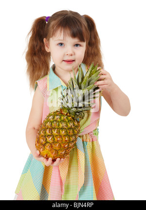 Child holding a large ripe pineapple isolated on a white background - Stock Photo