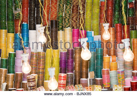 Bangles on a market stall - Stock Photo