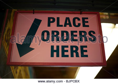 Sign at a restaurants - Stock Photo
