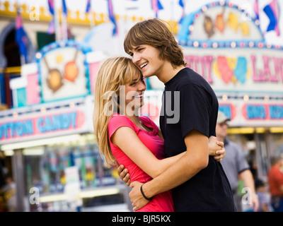 young couple at an amusement park - Stock Photo