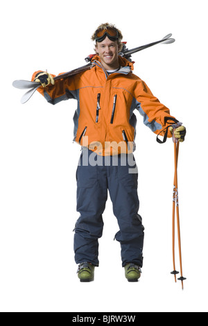 Male skier in orange ski jacket - Stock Photo