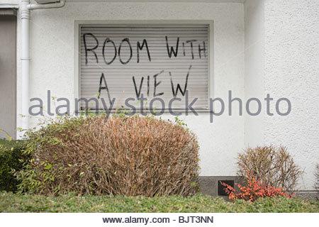 Graffiti on a windown shutter - Stock Photo