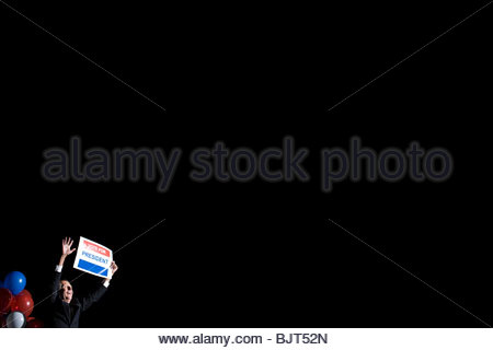 A politician holding a poster - Stock Photo