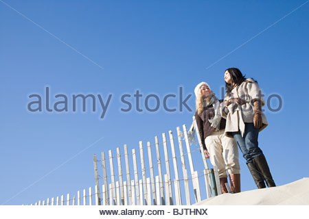 Two women at the beach - Stock Photo