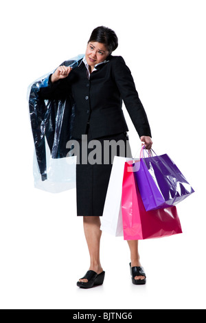 Woman with shopping bags talking on cellphone - Stock Photo
