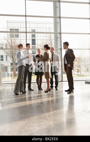 Happy business executives with champagne - Stock Photo