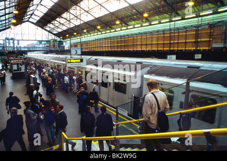 Earls Court Tube Station London Train With Doors Closed & Passengers Waiting - Stock Photo