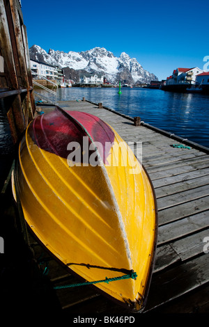 Fishing boat in harbour at Henningsvaer on Lofoten Islands in Norway - Stock Photo