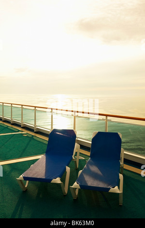 Lounge chairs on the deck of a cruise ship - Stock Photo