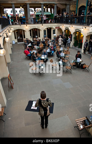 A singer performs at the market of Covent Garden in London, England, UK - Stock Photo
