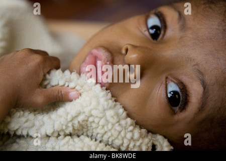 Child in orphanage - Tanzania, East Africa - Stock Photo