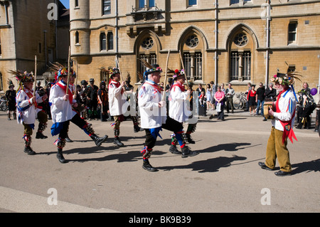 Morris dancers in action at the Oxford Folk Festival, dancing on Broad Street in front of Balliol college. - Stock Photo