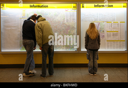 People standing in front of city and underground map, Berlin, Germany - Stock Photo