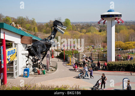 Giant LEGO Tyrannosaurus rex  and Space Tower ride, LEGOLAND Windsor - Stock Photo