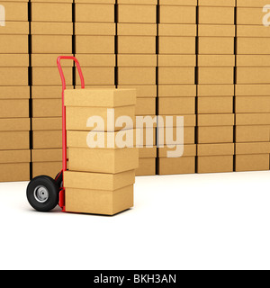 Red hand truck with three cardboard boxes - Stock Photo