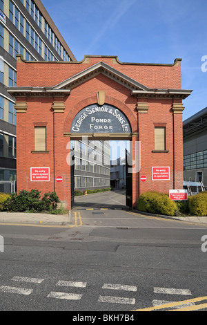 Preserved red brick entrance archway to George Senior & Sons iron foundry at Ponds Forge, Sheffield, South Yorkshire, - Stock Photo