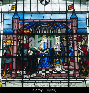 St. Botolph's church Stained glass window depicting William I conferring the patronage of St. Botolph's church - Stock Photo