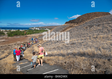Tour of Puukohola National Historic Site,Hawaii with Kawaihae Harbor in distance. - Stock Photo