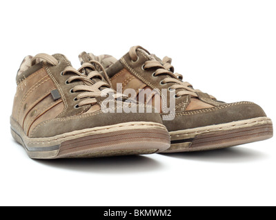 Pair of brown snickers shot on white background - Stock Photo