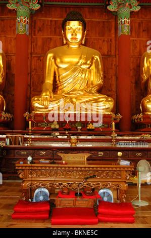 Golden Buddha Statue Inside Jogyesa Temple in Seoul, South Korea, Gyeonji-dong, Jongno-gu - Stock Photo
