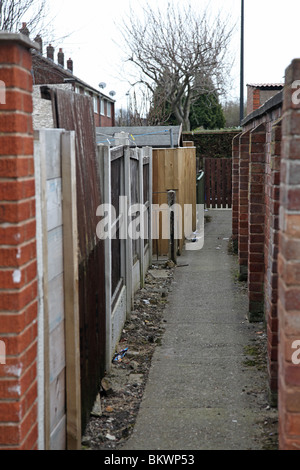 Typical alley behind social housing on estate - Stock Photo