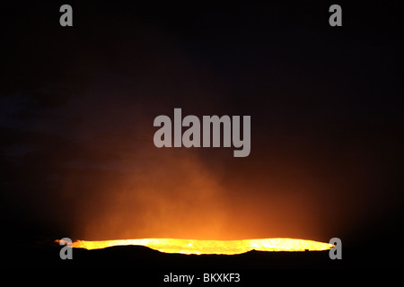 Derweze or Darvaza, aka as the Door to Hell is a huge crater of burning natural gas in the Kara-kum desert in Turkmenistan. - Stock Photo