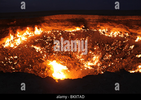 Derweze or Darvaza, aka the Door to Hell is a huge crater of burning natural gas in the Kara-kum desert in Turkmenistan. - Stock Photo