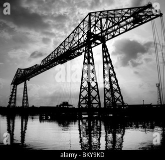 Transporter Bridge on river Tees in Middlesbrough with sun behind back lit silhouette atmospheric black & white - Stock Photo